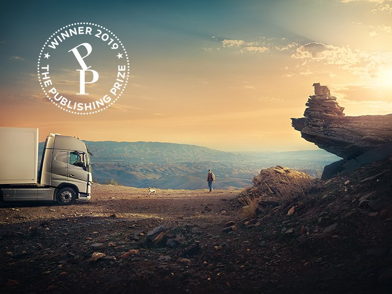 A Volvo truck with the driver taking a break, spectacular view when the sun set.